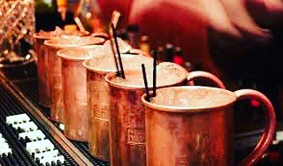 Mule it Monday! Everyone loves a copper mug so come enjoy $5 Moscow Mules made with Stoli Vodka and ginger beer! Gluten free and 5 favors available too! #moscowmulemondays #sportsbar #moscowmule #stolivodka #gingerbeer #coppermugs #lime #fivedollars #mondays