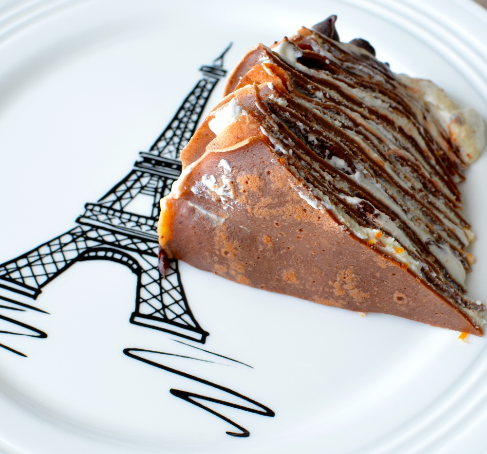 Chocolate Cannoli Crepe Cake with Vanilla Whipped Cream, Orange Cream Sauce and Chocolate Ganache