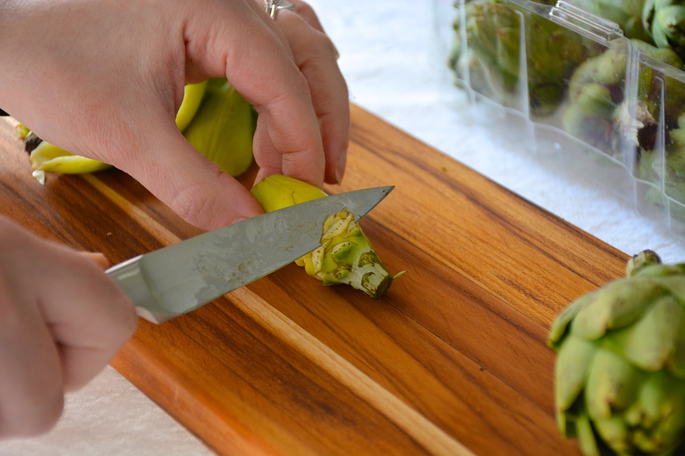 Use a pairing knife to remove the top layer of the removed leaves and the stem