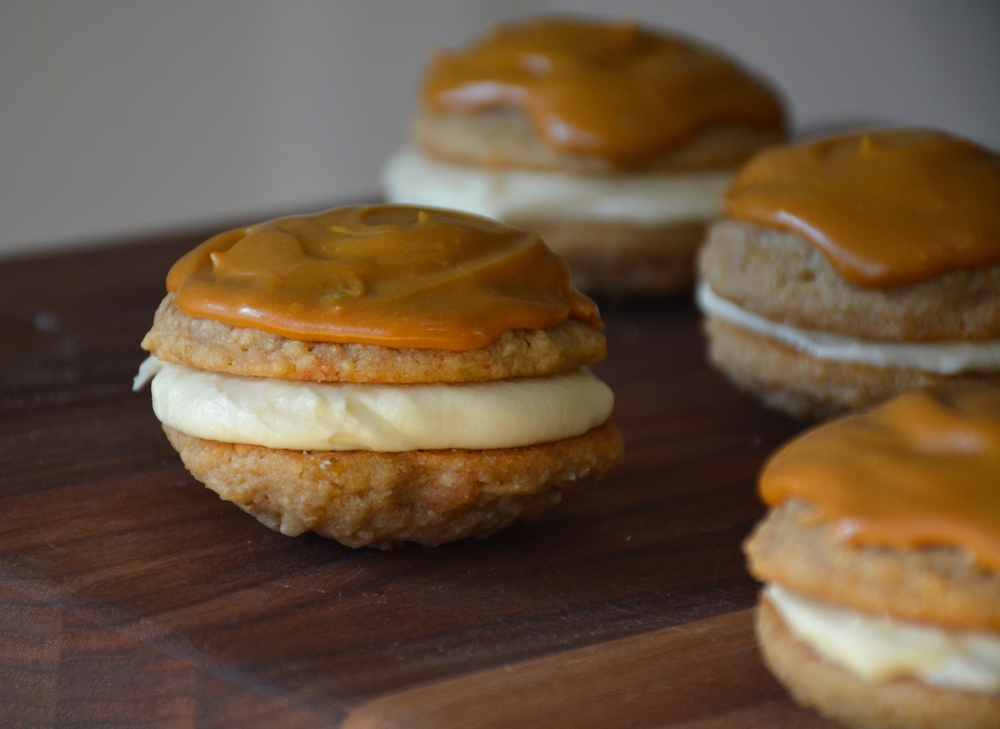 Banoffee Inspired Cookies - Banana Cookies with Vanilla Banana Cream Filling and Dulce de Leche Frosting