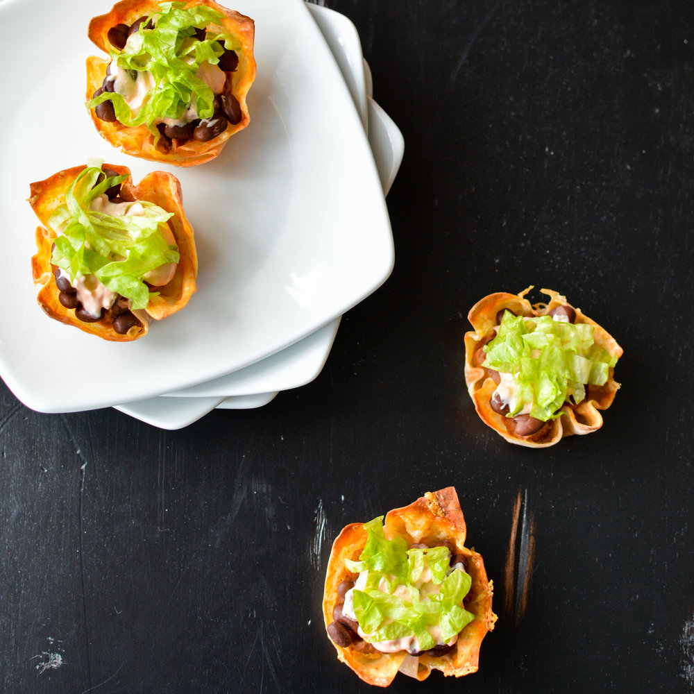 Black Bean Taco Dip in Crispy Cheddar Hot Sauce Cups