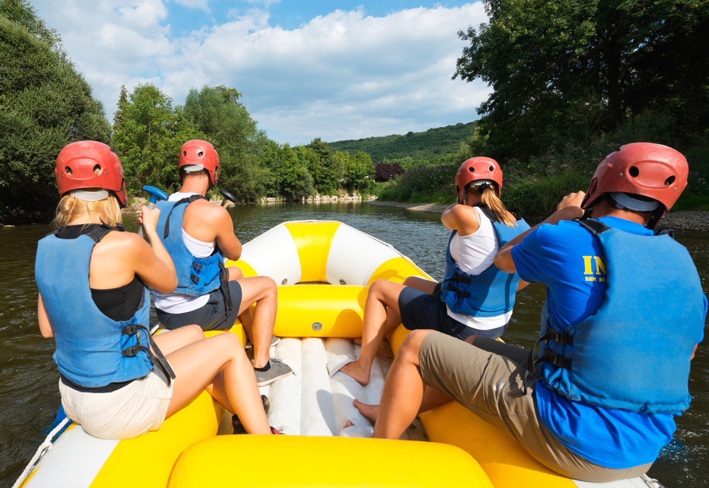 Always keep your hand on top of your T-grip while rafting (don't be like these guys on the left!)