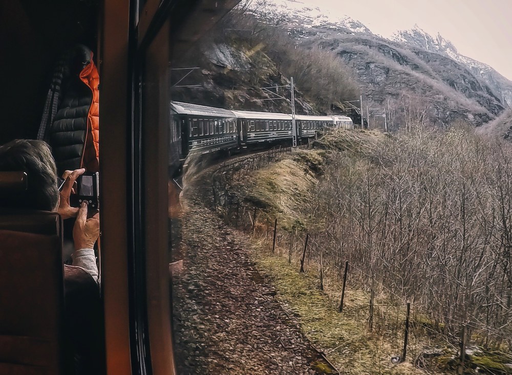A tourist capturing the view before the train enters a tunnel