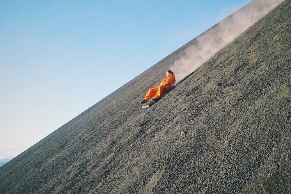 Boarding down the volcano - photo courtesy of Bigfoot Hostel