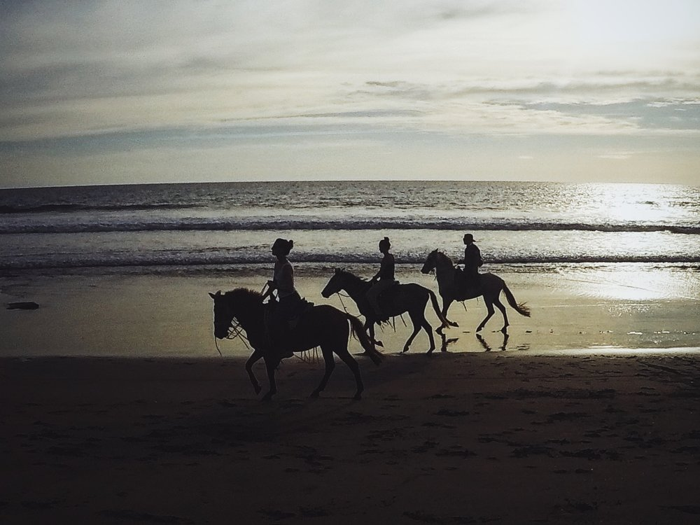 Amigas horseback riding