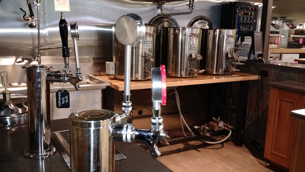 Three Keg Cap Tap handles in use with The Home Pubs brewing system.