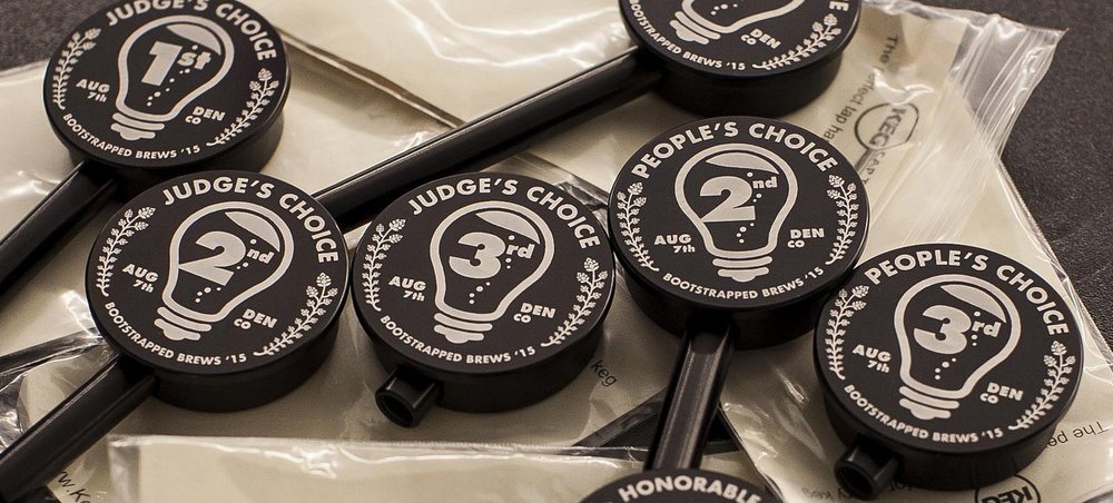 Custom Keg Cap Tap handles awarded as trophies to top brewers at the event.
