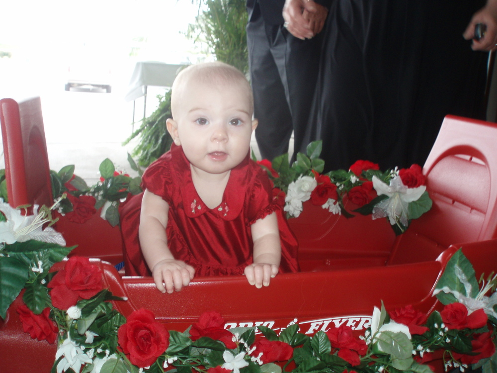 The Flower Girl in her Little Red Wagon!
