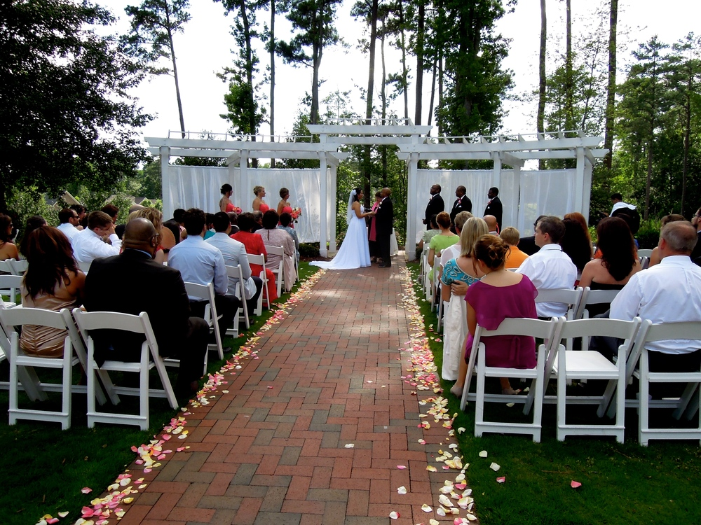 A beautiful wedding in the Jasmine Courtyard of Brier Creek Country Club in Brier Creek--Raleigh