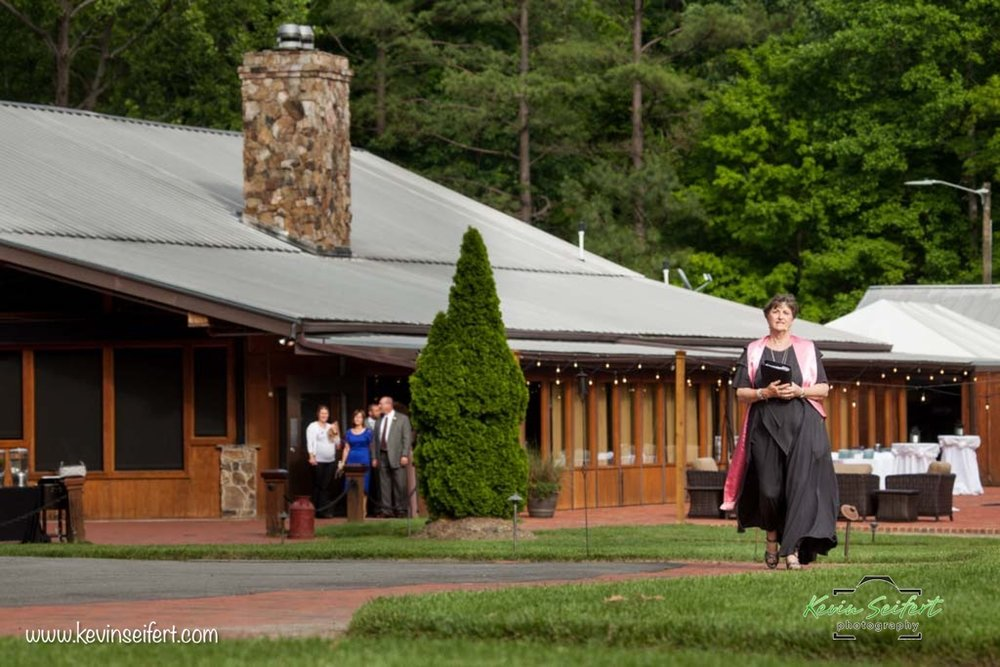 Starting the processional for the wedding of Kelsey and Ryan at The Pavilion at Angus Barn