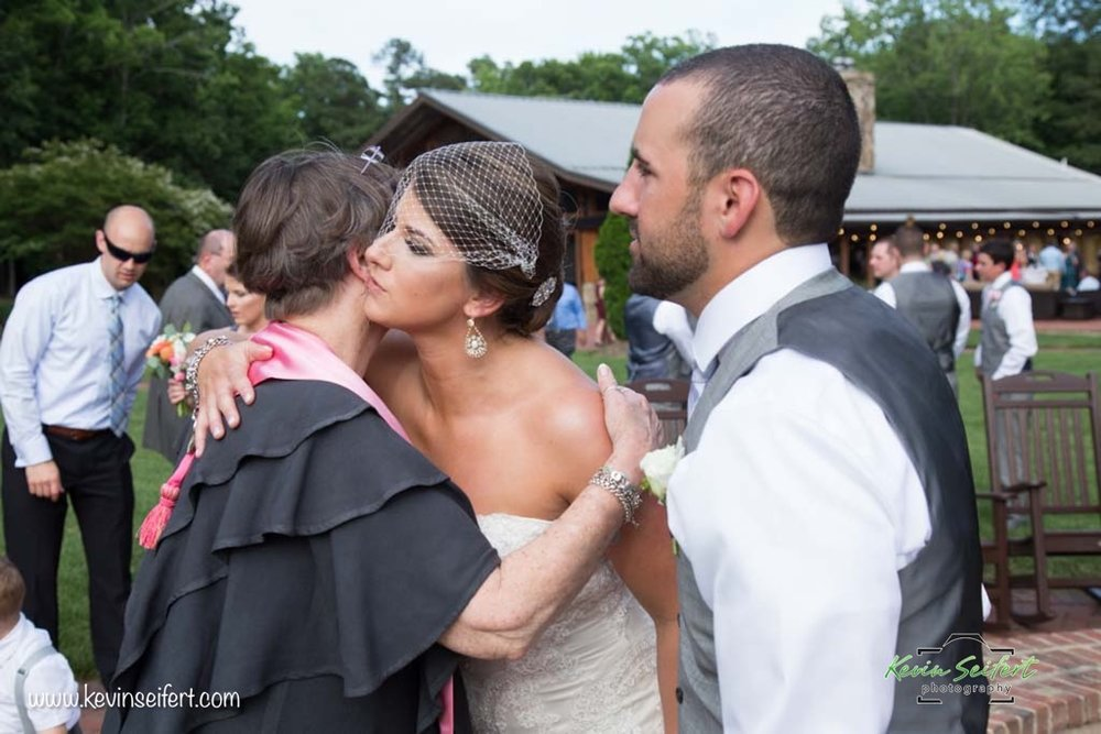 Hugs and Congratulations to the newlyweds on their marriage at Angus Barn Pavilion