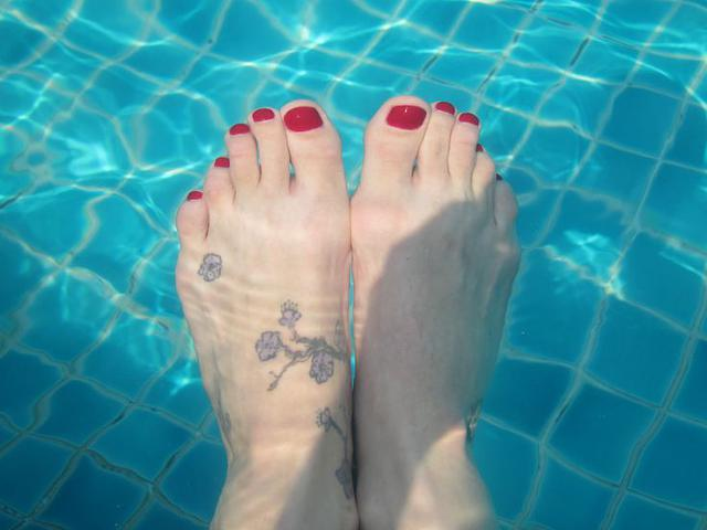 Cherry Red Toes in a Turquoise Pool