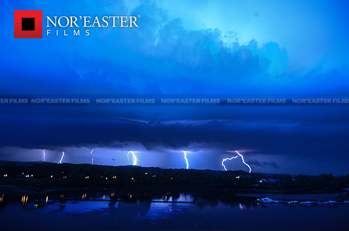 Multiple lightning strikes over the Hudson River at Troy, New York.