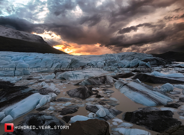 The sunset over the calving face and the meltwater lagoon of the Svínafellsjökull Glacier in Southern Iceland.