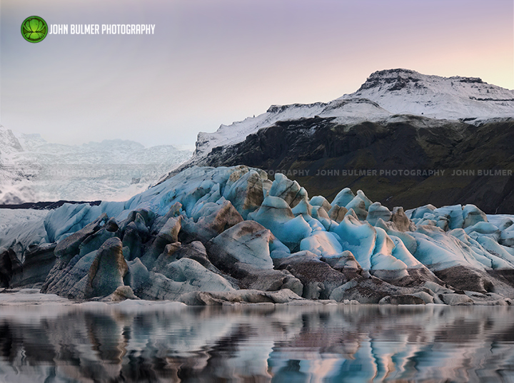 The blue ice and meltwater of Iceland's Svínafellsjökull Glacier.