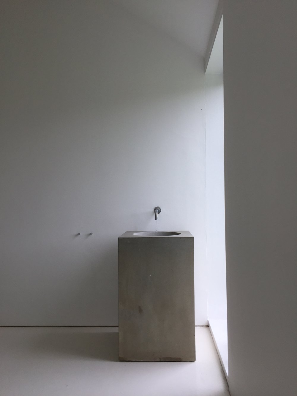I just adore the simplicity of design of this concrete basin, creates a real calmness. This stunning location, 'Tilty Barn' was remodelled by Architect John Pawson