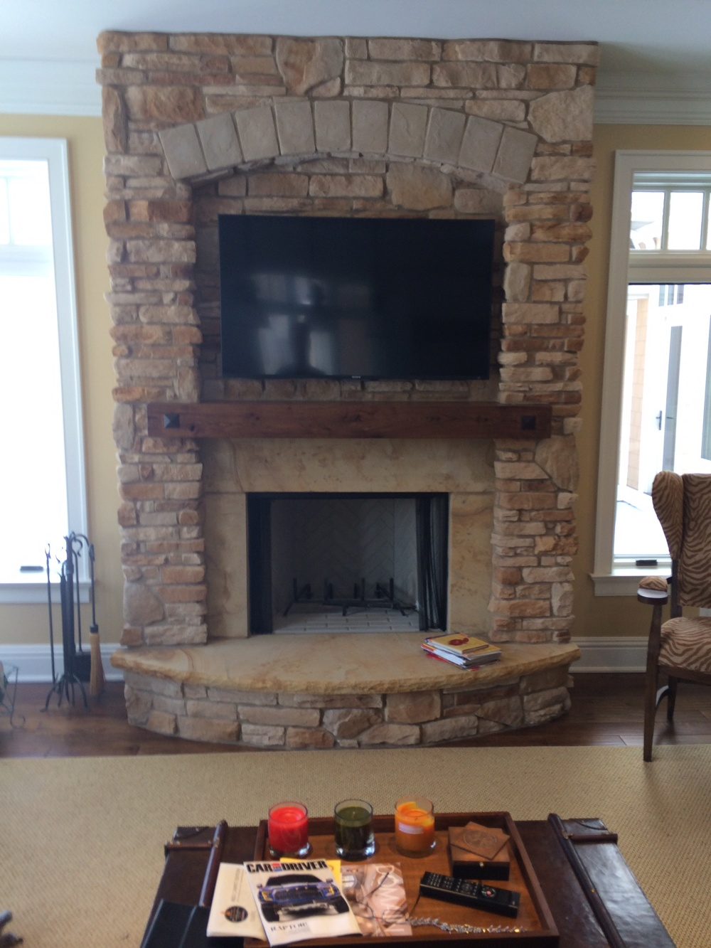 Custom Stone Fireplace w/ Arched Hearth