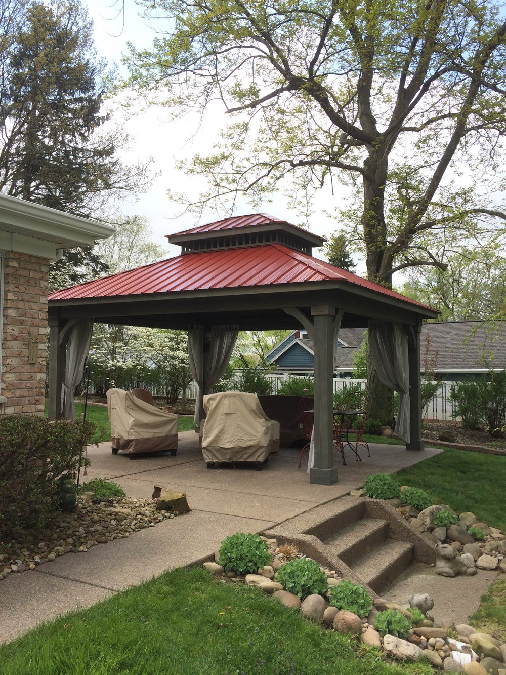 Cascade with gray stain red metal roof.JPG