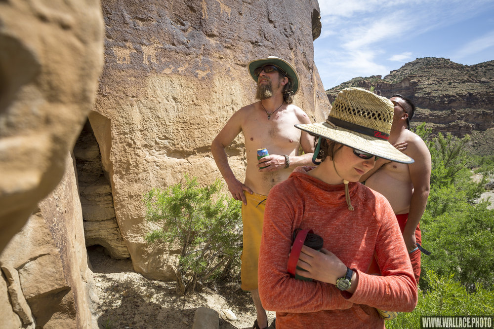 The gang checks out petroglyphs in Desolation Canyon, Utah.