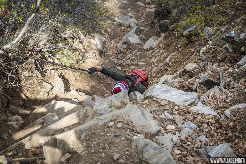 Sydney uses a chain to descend a steeper section of the Gunnison route.