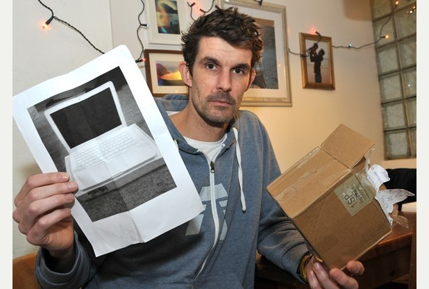 Image of Paul Barrington and printed MacBook as published by Express and Echo.