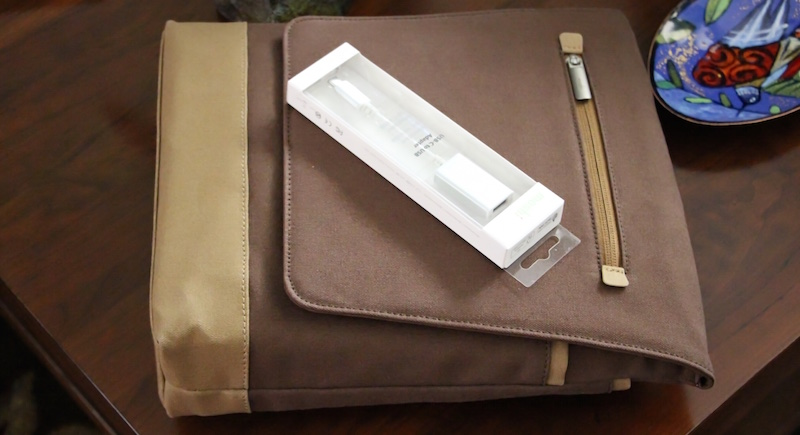 Moshi Aerio Lite Messenger bag and USB-C to USB adapter. Photo ©2015, Steven Sande. All rights reserved.