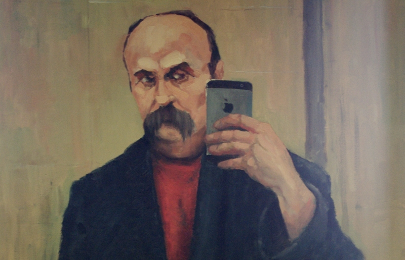 Taras Shevchenko and iPhone/painting in MacPaw Offices. Photo by Krystian Kozerawski