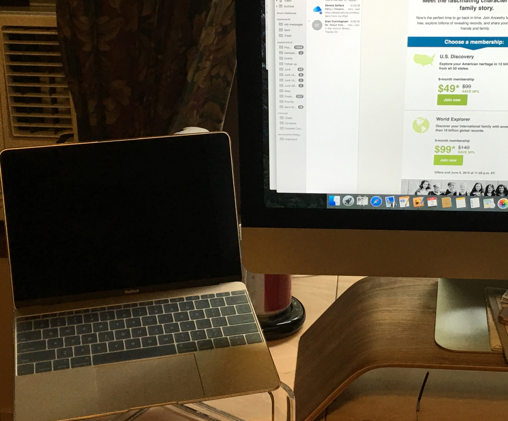 My 12-inch MacBook sits on is GhostStand next to its big brother, a 27-inch iMac.