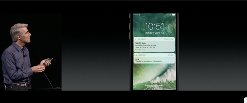 Craig Federighi showing the new Lock screen with better notifications, all made available through Raise To Wake