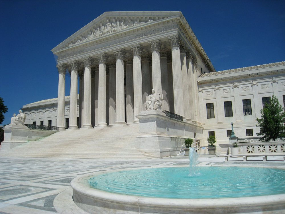 US Supreme Court Building. Image via Wikimedia (Public Domain)