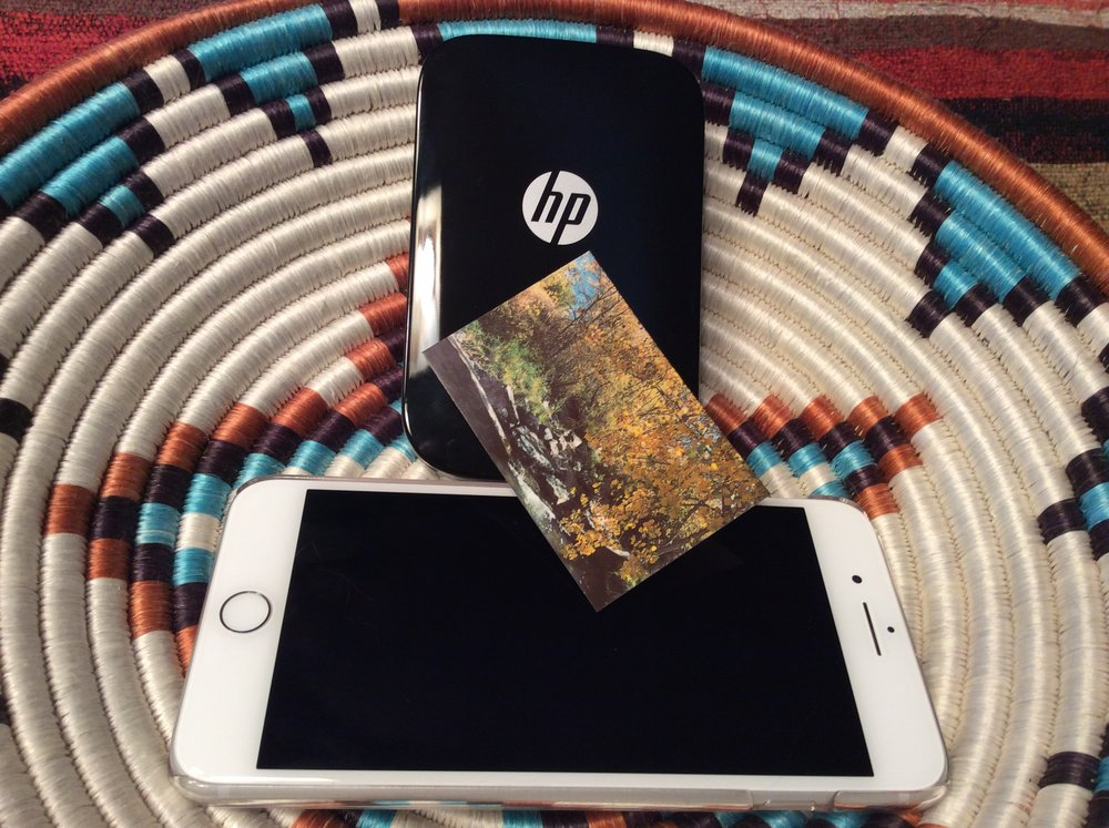 HP Sprocket photo printer, iPhone 7 Plus, and a printed photo. Photo ©2016, Steven Sande
