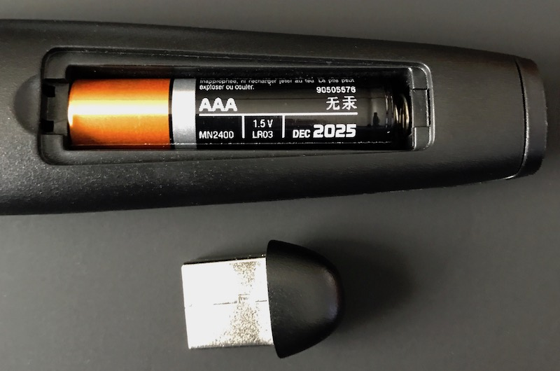 A picture from the School of Regrettable Design: the disposable battery and the dongle.