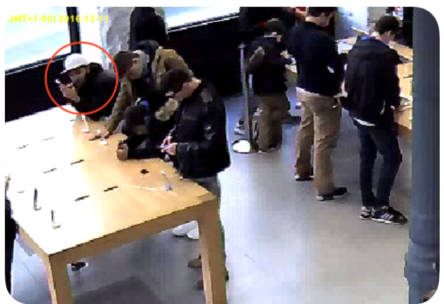 Security camera footage from a Madrid Apple Store showing a thief in action