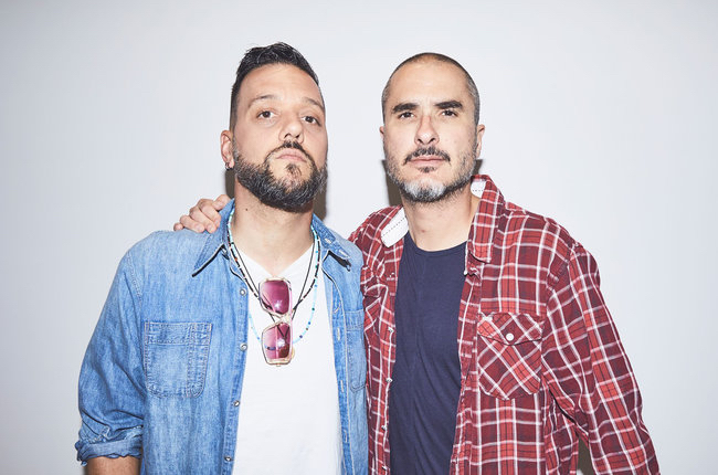 "Pictured is George Stroumboulopoulos and Zane Lowe, courtesy of ""Billboard."""