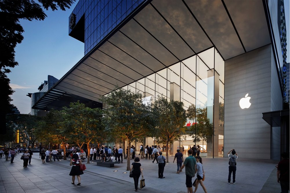 The 120-foot glass facade blurs the barrier between inside and out, while 16 interior trees continue the city's lush greenery throughout the space. Photo courtesy of Apple.