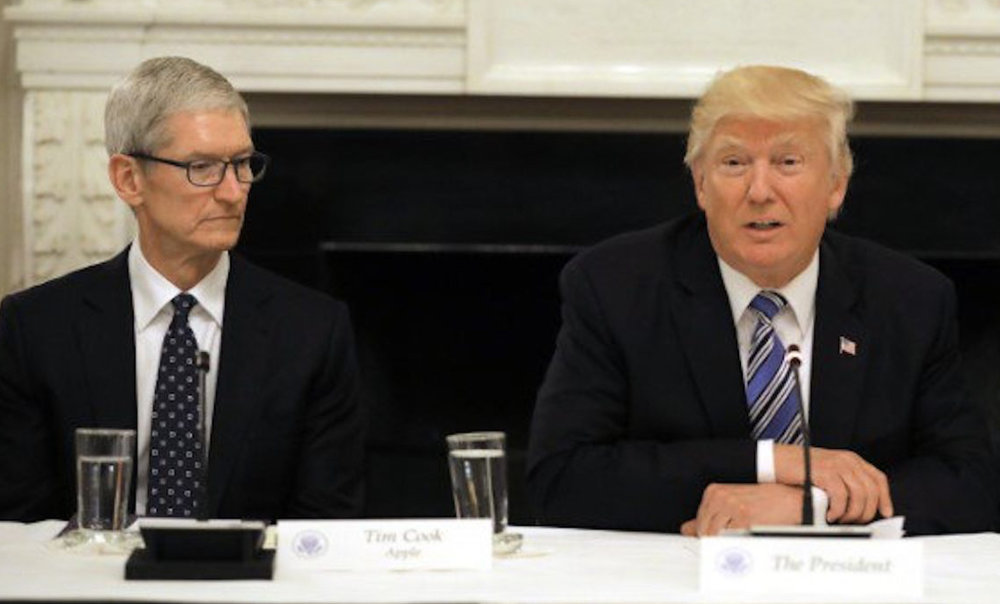 "Pictured: Apple CEO Tim Cook and President Donald Trump. Photo courtesy of ""Reuters."""