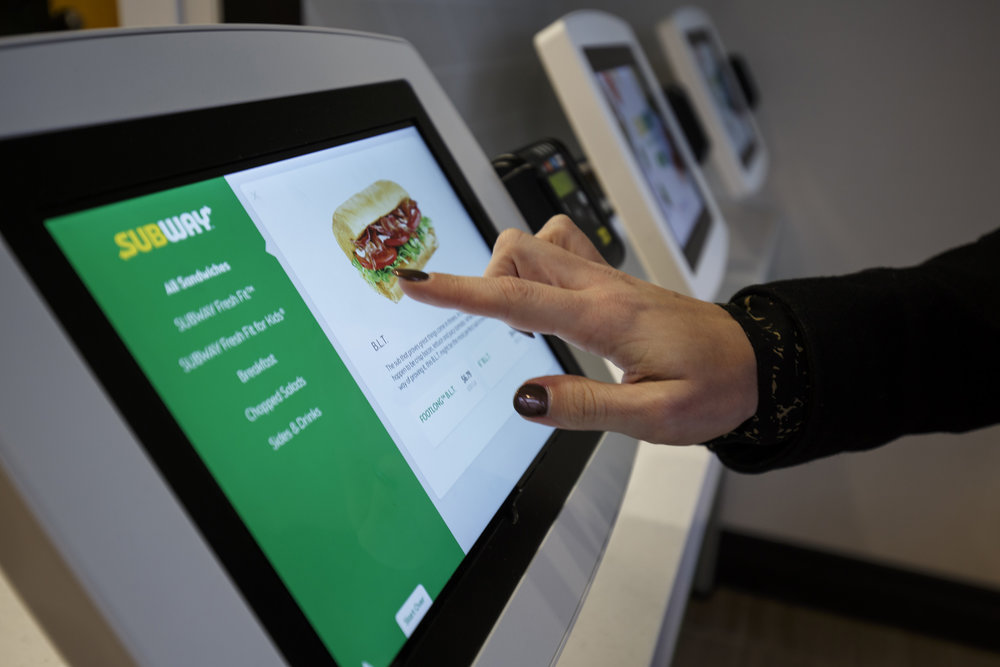 photo image Subway testing self-serve kiosks that take Apple Pay, mobile ordering, and more