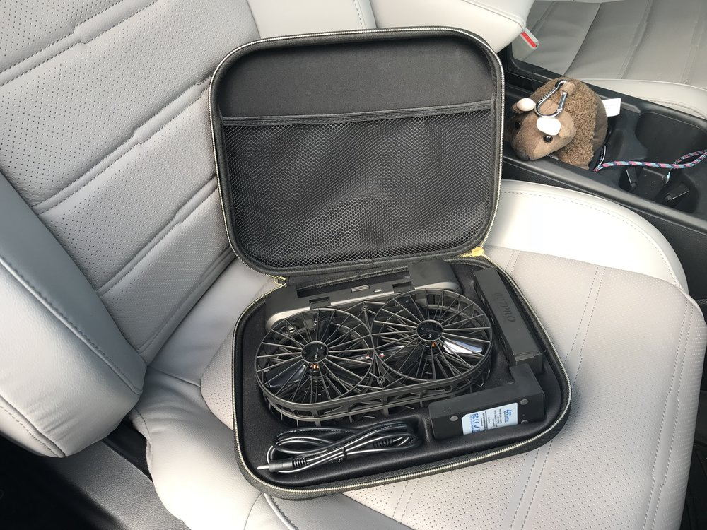 The Moment Drone in its case with (counterclockwise from left front) car adapter, charger, and battery pack.