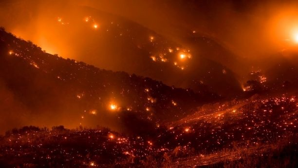 A hillside glows with embers as the Thomas fire burns through Los Padres National Forest near Ojai, Calif.  (AP)