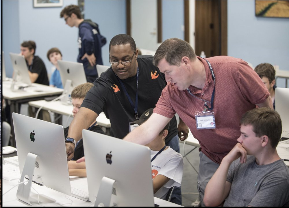 App Camp instructors Charles Long and Bob Williams help teach students how to make apps using Apple's Swift programming language. The co-ed app camp, located in Asheville, NC, offers two one-week sessions in July for teens across the U.S. and abroad.