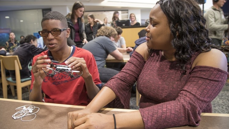 Cameron Smith, 15, left and Demetria Ober, 18, work with a drone during class at the Texas School for the Blind and Visually Impaired. — Photo courtesy of Ricardo Brazzill/American Statesman