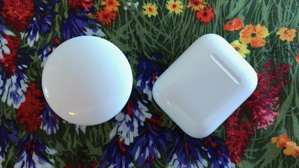 FIBARO's The Button (left) next to an AirPods case (right)