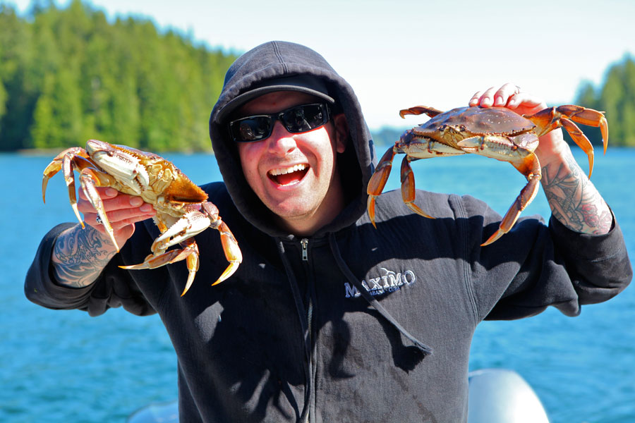 All smiles with these two crab on a fishing charter in Tofino, BC.