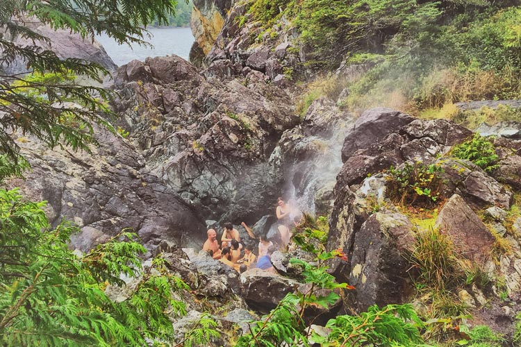 Friends in geothermal pool at hot springs cove. Tofino, BC.