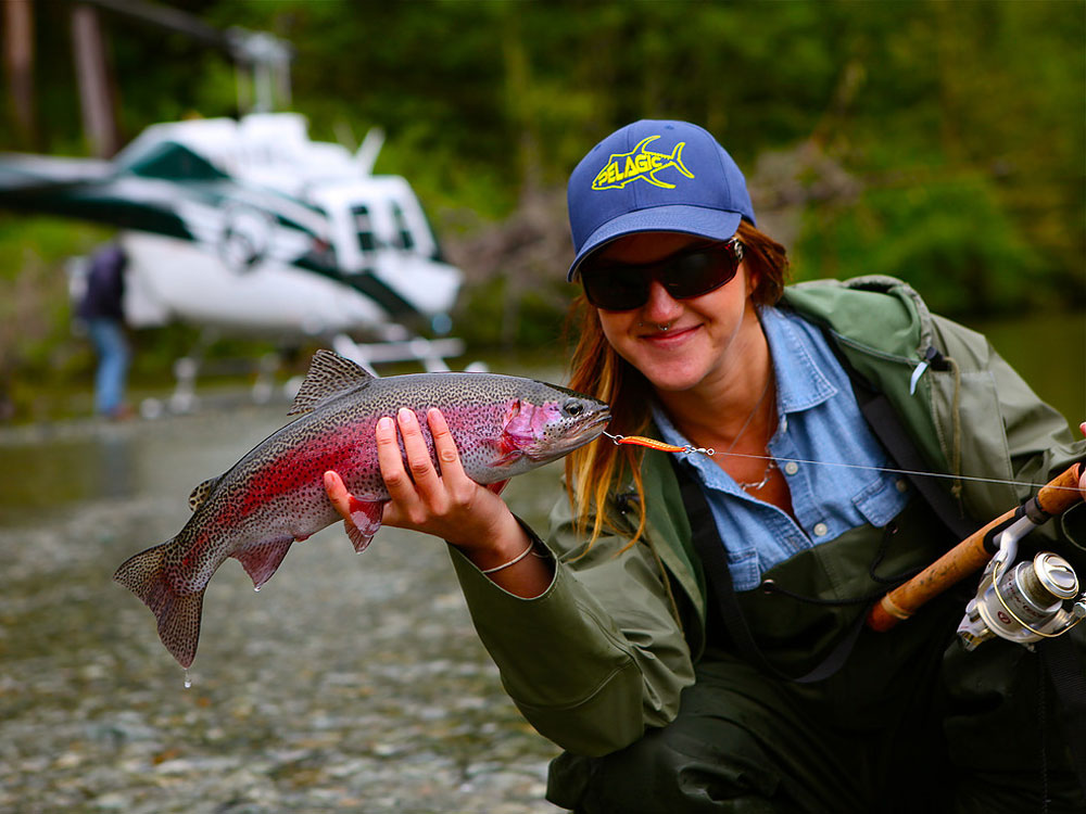 A woman with an alpine rainbow trout near Clayoquot Sound.