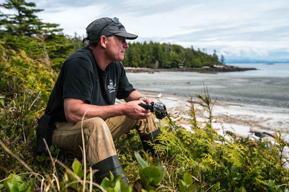 Ian McAllister on the West Coast with camera in hand.