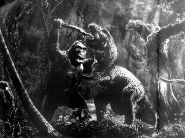 Kong fights the T-rex.