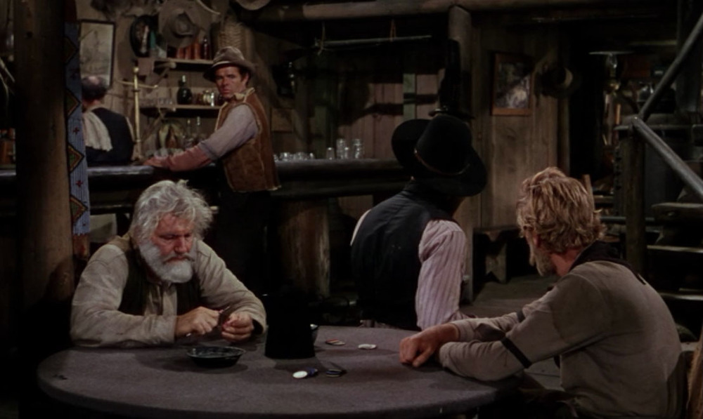 Front, from left to right, Rufus Ryker (Emile Meyer), Jack Wilson (Jack Palance), and Morgan Ryker (John Dierkes).