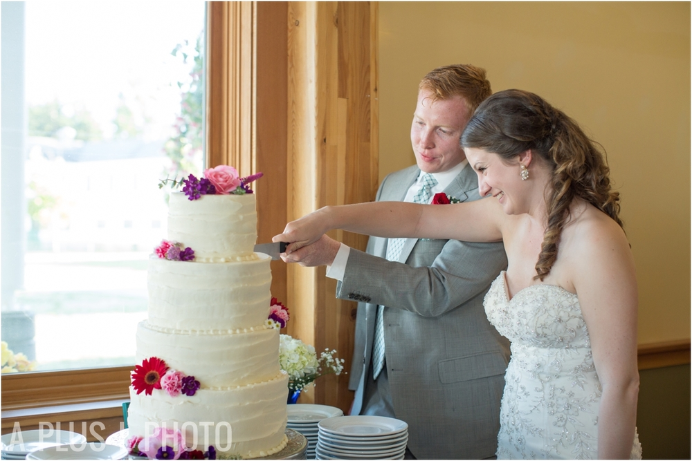 Bride and Groom Cake Cutting - Fort Worden Wedding - A Plus L Photo