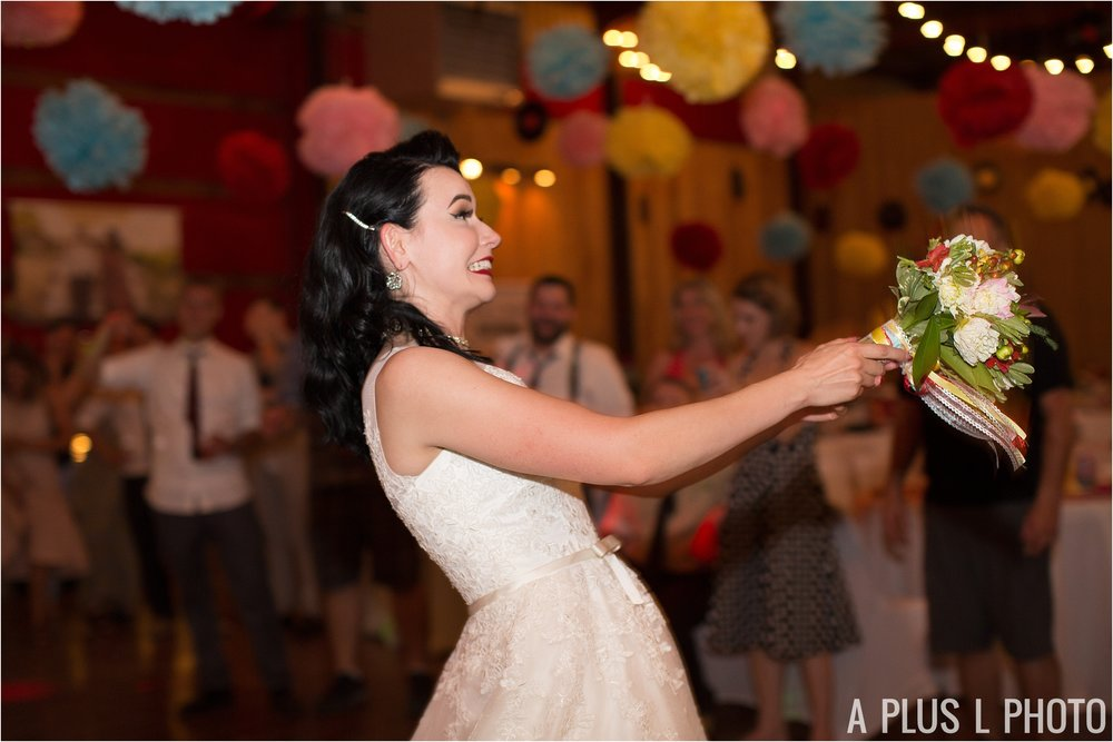 Colorful Rockabilly Wedding - Bouquet Toss - Heart of Rock - A Plus L Photo